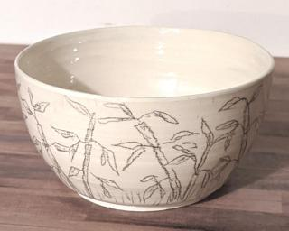 Adorn your home with this unique planter decorated with bamboo sketches around the outside.