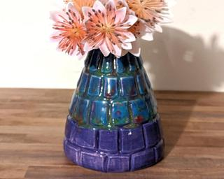 Adorn your home with this one of a kind little carved vase with colors reminiscent of a Monet painting.