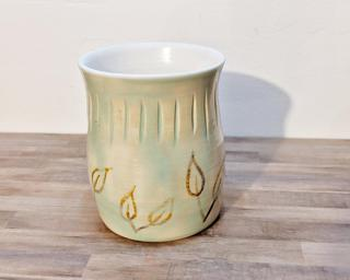 Adorn your home with this one of a kind vase designed with abstract yellow leaves.