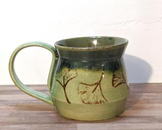 A lovely ceramic mug with gorgeous green glazes inside and out and stamped with ginkgo leaves.