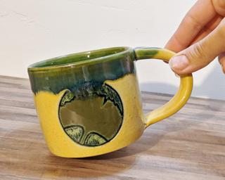 A hefty ceramic mug with a gorgeous ginkgo leaf carved on either side.