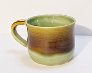 A nice Earthy-toned glazed ceramic mug, perfect for a morning cup of coffee.