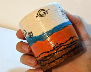 Add to your cup collection with this hand-painted tumbler.