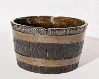 Adorn your home with this rustic glazed planter.