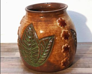 Adorn your home with this one of a kind little carved vase.
