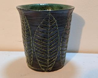Add to your cup collection with this hand carved tumbler.