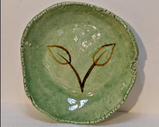A lovely green dish for your dresser.