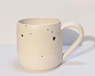 A nice speckled ceramic mug, perfect for a morning cup of coffee.