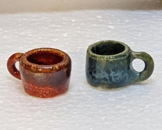 Have you ever seen mugs so small before? These would make a great addition to one's doll house accessories' collection.