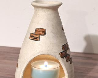 A lovely little candle holder for your table.