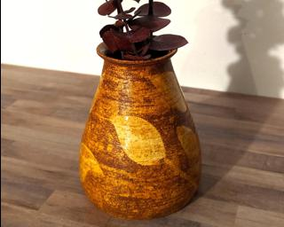 Welcome fall in your home with this one of a kind leafy flower vase.
