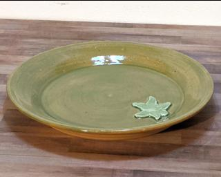A lovely green dinner plate for your table.
