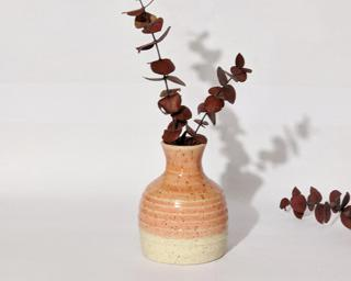 Adorn your home with this pink speckled vase.