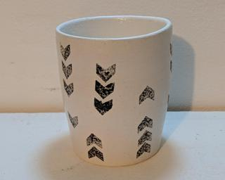Add to your cup collection with this little stamped ceramic tumbler.