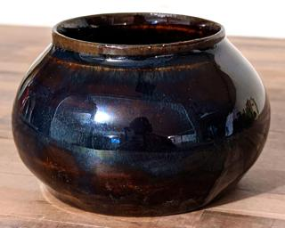 Adorn your home with this stunning little planter with a deep blue glaze.