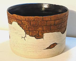 Adorn your home with this one of a kind carved planter.