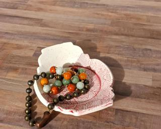 A sweet little jewelry dish for your dresser.