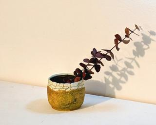 Adorn your home with this one of a kind glazed planter.