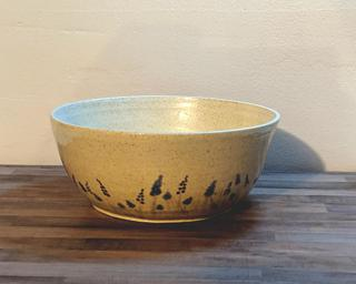 Adorn your home with this sweet serving bowl painted with little blue and purple lavender .