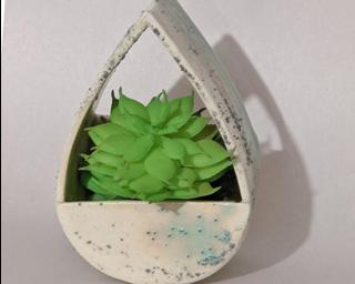 A sweet little vase or planter for your wall.