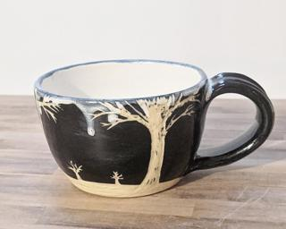 A carefully carved ceramic mug, perfect for a morning latte.