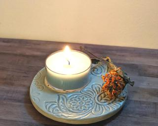 A lovely light green candle dish for your table.