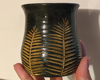 Adorn your home with this one of a kind vase which sports multiple carved pine tree-like branches.
