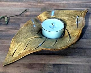 A tealight candle holder for your table.
