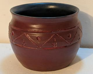 Adorn your home with this one of a kind tribal-inspired carved planter.