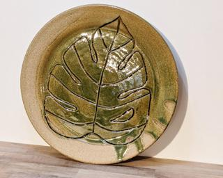 A sweet little leaf dish for your dresser or table.