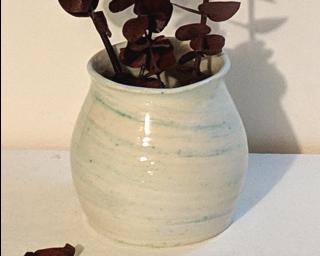 Adorn your home with this one of a kind marbled vase.