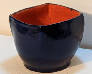 Adorn your home with this deep sapphire blue (exterior) and bright orange (interior) squared planter.