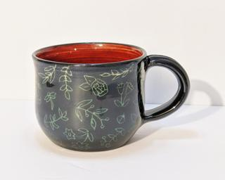 A carefully carved ceramic mug, perfect for a morning cup of coffee.