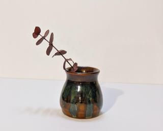 Adorn your home with this one of a kind little drippy vase.