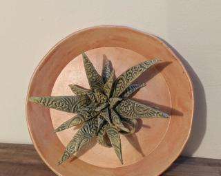 This pink ring dish with a stamped aloe plant would make such a sweet little addition to your dresser.