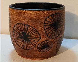 Adorn your home with this one of a kind painted planter.