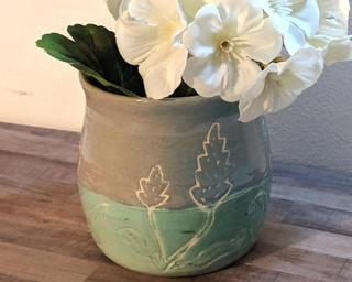 Adorn your home with this one of a kind colored vase.