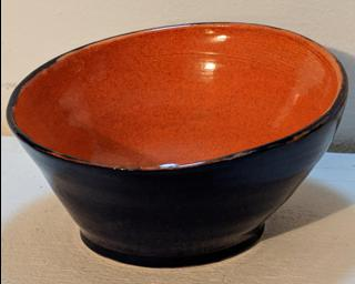 Adorn your home with this deep sapphire blue (exterior) and bright orange (interior) planter.