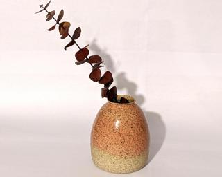 Adorn your home with this one of a kind specked vase.